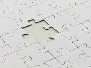 Close up of an incomplete white puzzle