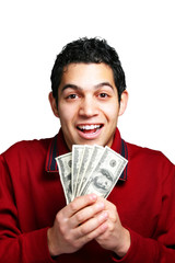 Young hispanic man holding hundred dollar bills