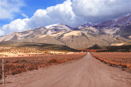 Long unpaved road to mountains