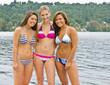 Friends in bikinis near lake