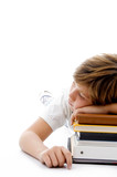 half length view of boy sleeping on books