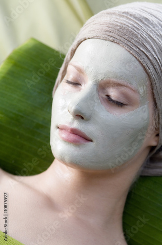 Young Woman face with beauty mask, shut eyes
