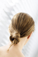 Young woman with wet hair, view from the back, close up (studio)