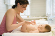 Mother and naked baby, skin care
