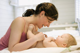 Mother and naked baby