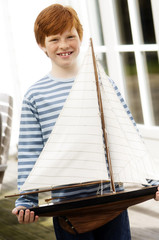 Boy holding a model boat