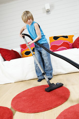 Young boy with vacuum cleaner