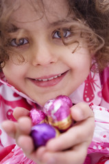 Little girl holding Easter eggs