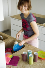 Young woman washing the dishes