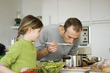 Man and little girl cooking