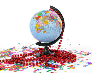 World globe and colorful confetti