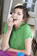 Young woman eating an hard-boiled egg