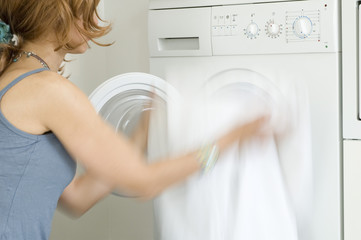 Woman emptying washing machine