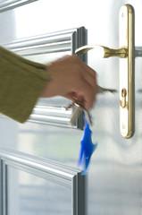 Woman locking the door, close-up