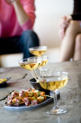 Close-up of glasses of champagne and cocktail snacks