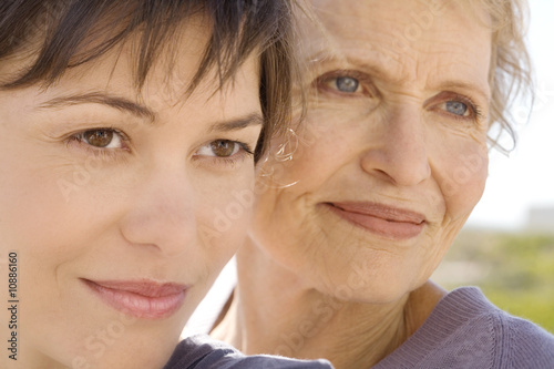 Senior woman and adult daughter, outdoors