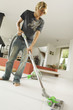 Teenager vacuuming, indoors