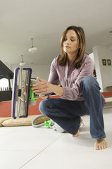 Woman holding a vacuum cleaner, indoors