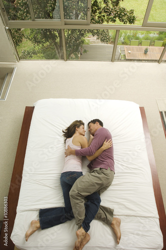 Couple sleeping in a bed, view from above, indoors