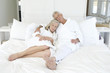 Couple in bathrobe sleeping in bed