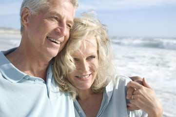 Portrait of smilin couple on the beach