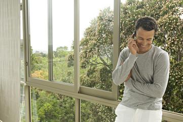 Man phoning, indoors