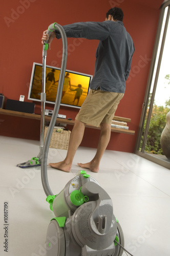 Man vacuuming, indoors