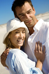 Portrait of a couple embracing, on the beach