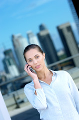 Young businesswoman using mobile phone, portrait