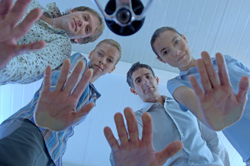 Business people showing hands, low angle view