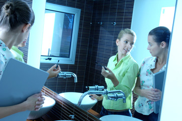 Young women discussing in washroom