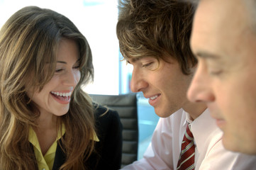 Business people smiling in office, close-up