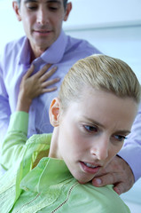 Female executive pushing male colleague in office