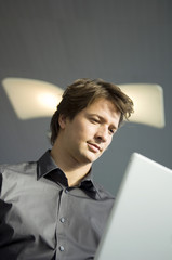 Low angle view of a businessman working on a laptop
