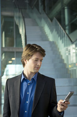 Businessman text messaging with a mobile phone