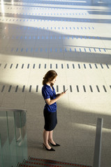 Businesswoman text messaging with a mobile phone