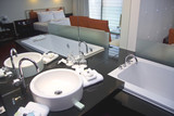 White bathtub and sink in spa hotel room poster