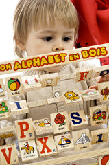 Close-up of a baby boy playing with alphabet blocks