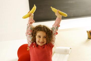 Girl holding two bananas