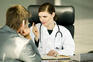 Female doctor explaining to a patient