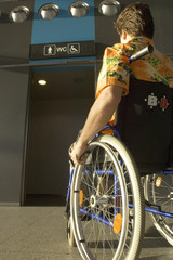 Rear view of a mid adult man sitting in a wheelchair