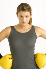 Portrait of a female boxer with arms akimbo