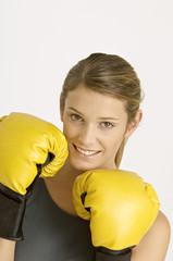 Portrait of a female boxer smiling