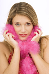 Portrait of a young woman with a feather boa around her neck