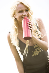 Young woman holding a thermos bottle