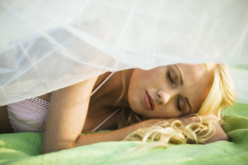 Portrait of young woman sleeping