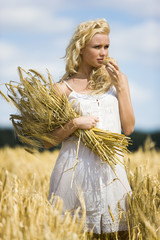 Young woman in a wheat field