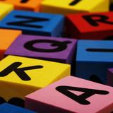 Colorful foam letter blocks poster