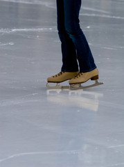 Woman with skates on ice rink