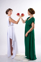 Two ladies and two apples